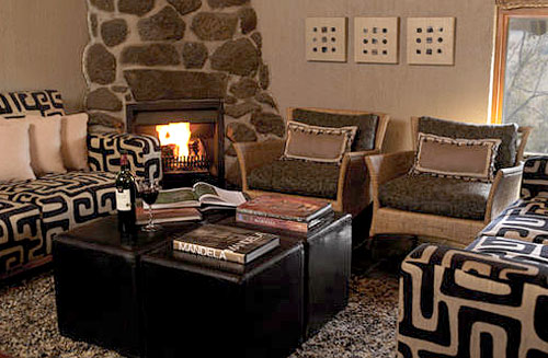Cozy Lounge with Fireplace at Tshukudu Bush Lodge, Luxury Accommodation at Pilanesberg Game Reserve - Accommodation Bookings